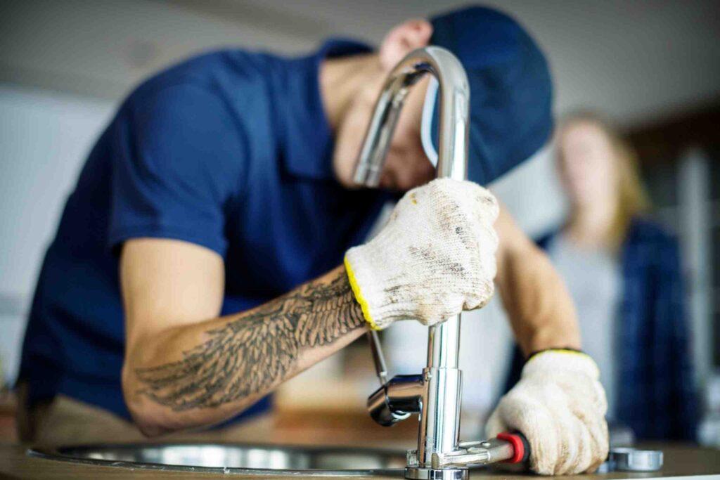 plumber-fixing-kitchen-sink